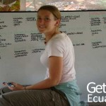 Happy Volunteer Writing on a Board Ecuador