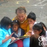 Volunteer reading book to Ecuadorian kids